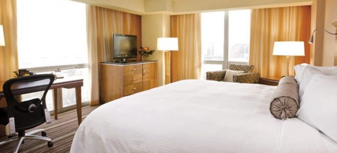 Photo of a hotel bedroom with queen sized bed