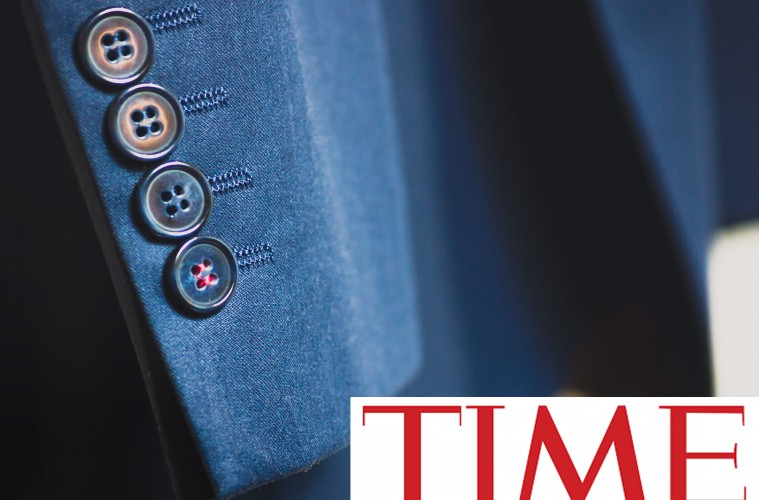 TIME magazine on a picture of a coat sleeve with buttons