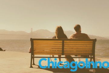 Chicagolnno logo on a photo of a couple on a bench watching the water