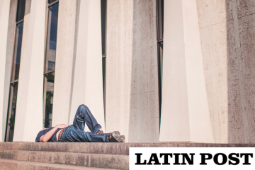 Latin Post on a photo of a man lying down on top of steps