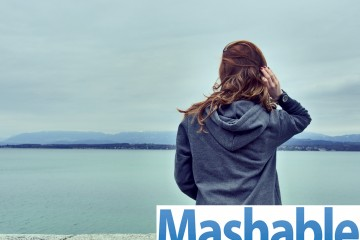 Mashable logo on a photo of a woman looking at the water