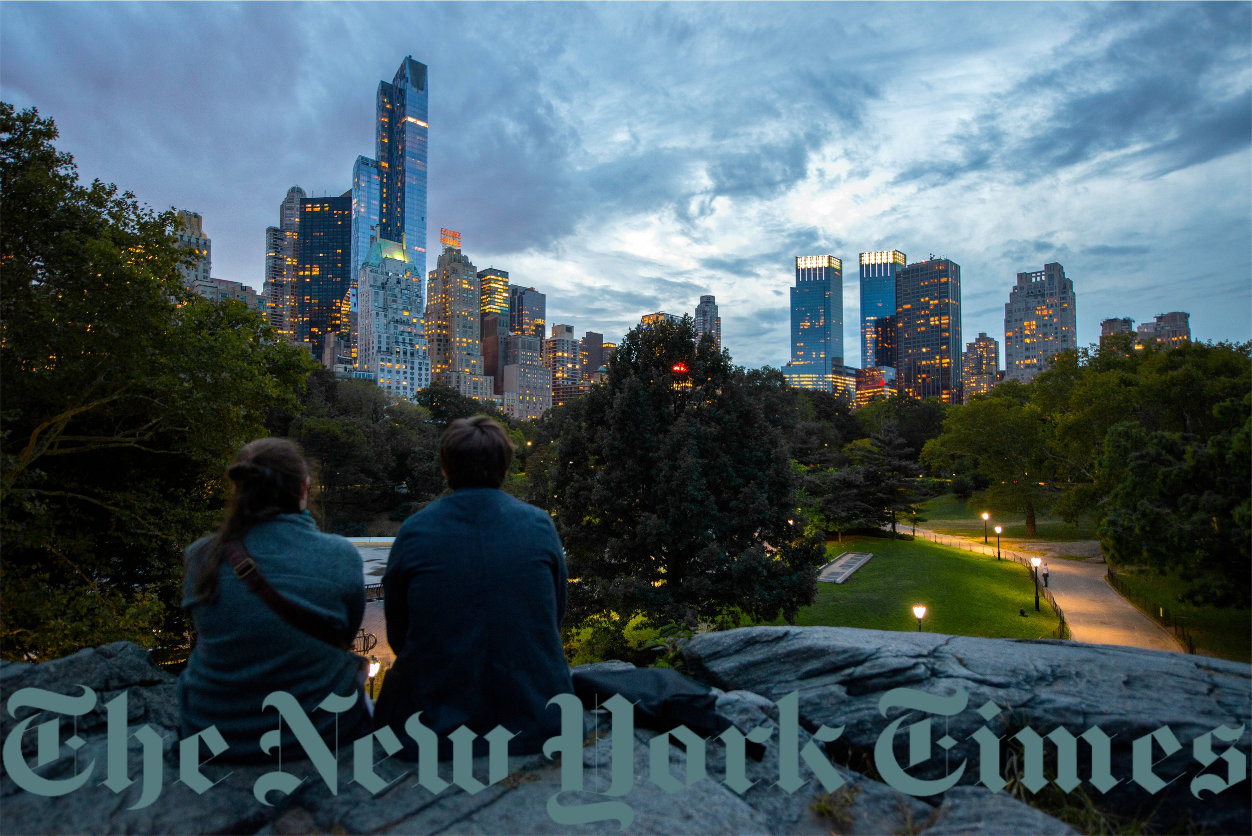 New York Times logo watermarked on a photo of a couple overlooking a park