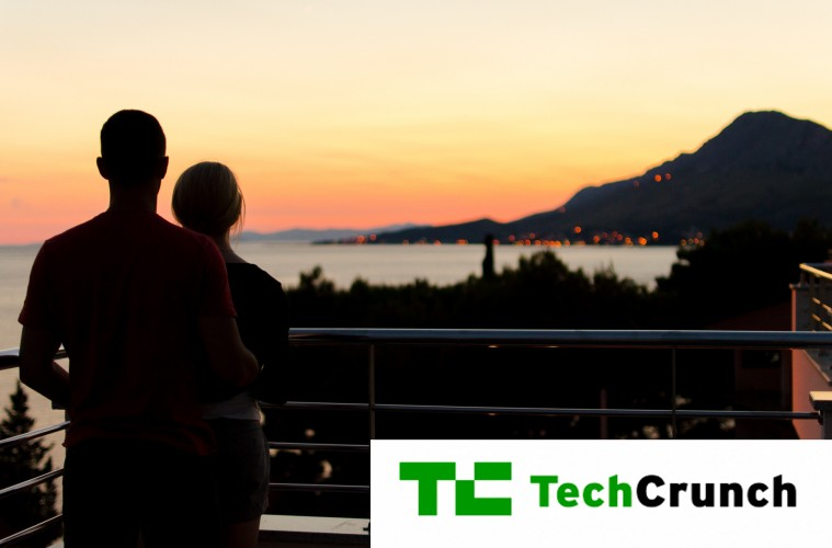 Tech Crunch logo on a photo of a couple on balcony watching the sunset