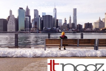 tnooz logo on a photo of a man on a bench facing the water