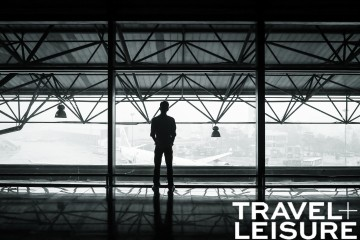 Travel + Leisure logo on a photo of a man in the airport