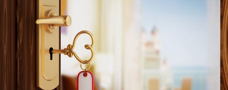 Heart shaped hotel room key on the door