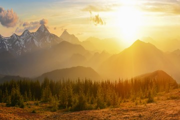 Picture of a sunrise or sunset over mountains