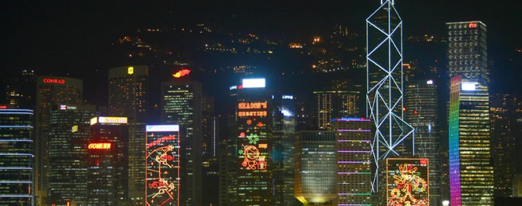 Hong Kong skyline from Victoria Harbour decorated with Christmas display lights.