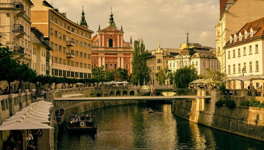The Ljubljanica River winds through Ljubljana, Slovenia on a sunny afternoon.