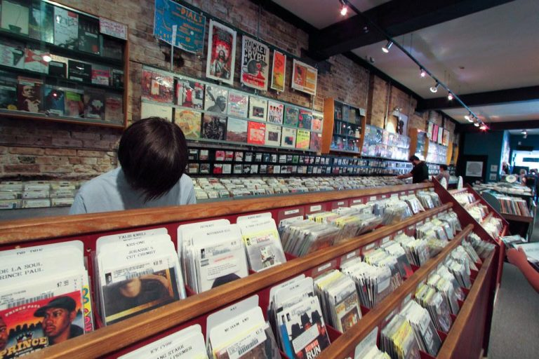 A customer thumbs through myriad vinyl records at Reckless Records in Chicago's Wicker Park neighborhood.