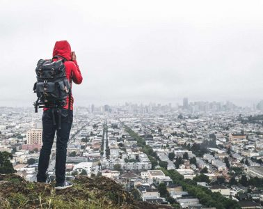Man taking picture while on an urban day hike in San Francisco.