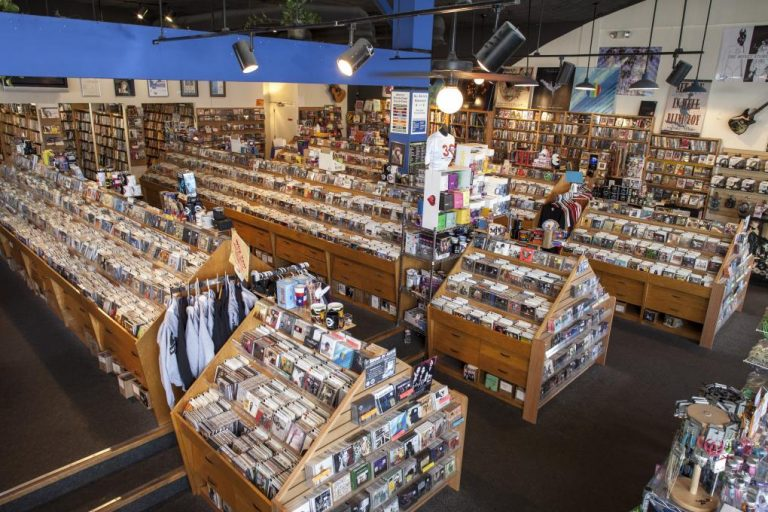 Rows and rows of record shelves filled with vinyl inside the famed Waterloo Records in Austin, Tx.
