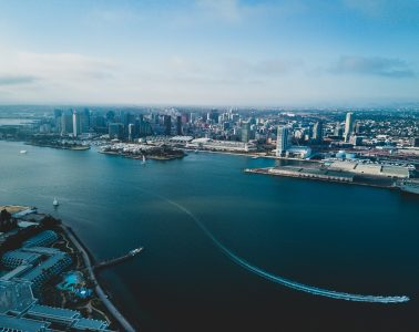 Aerial view of downtown San Diego and the San Diego Bay on a clear afternoon.
