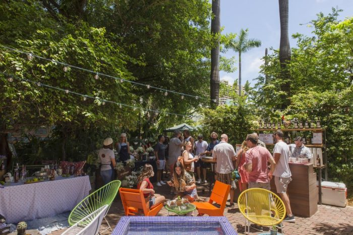A crowded patio on a clear sunny day at Broken Shaker-Miami, Florida