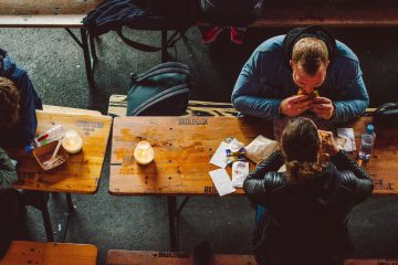 Overhead shot of two people devouring a delicious lunch in a market.